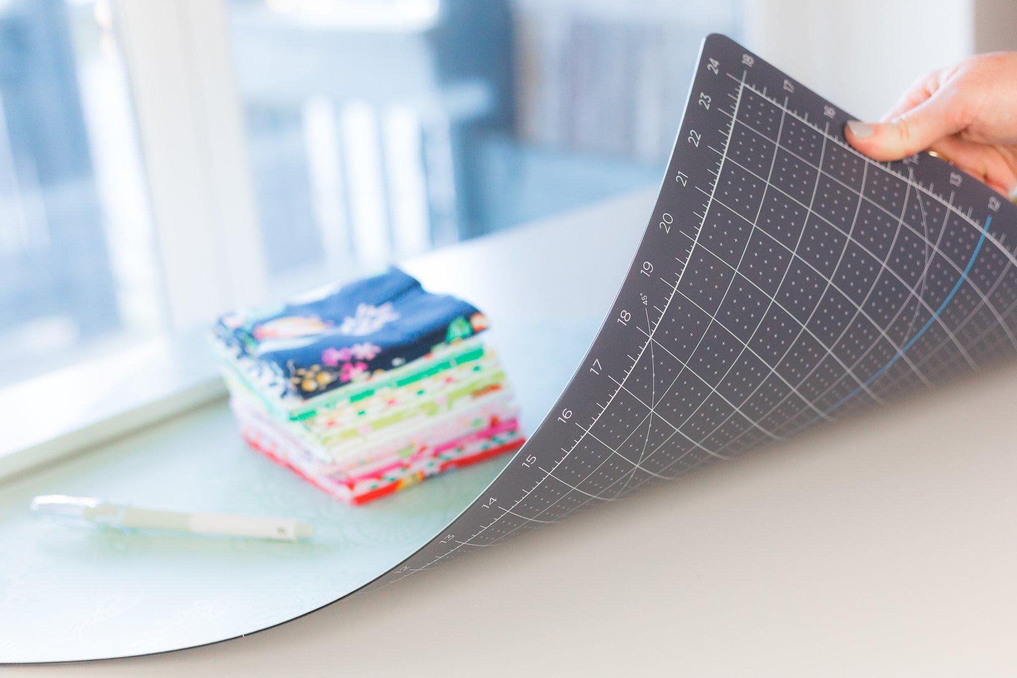 fat quarters sitting on fabric cutting mat
