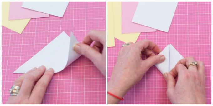 fold white cardstock into triangle on pink mat