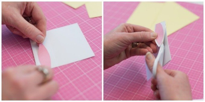 place pink cardstock ear on white cardstock