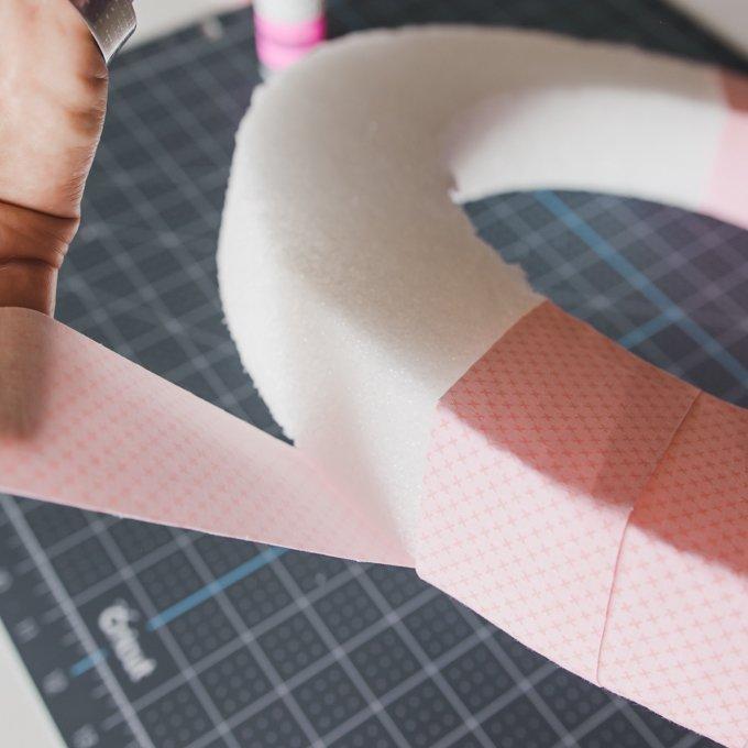 wrap pink fabric around foam wreath
