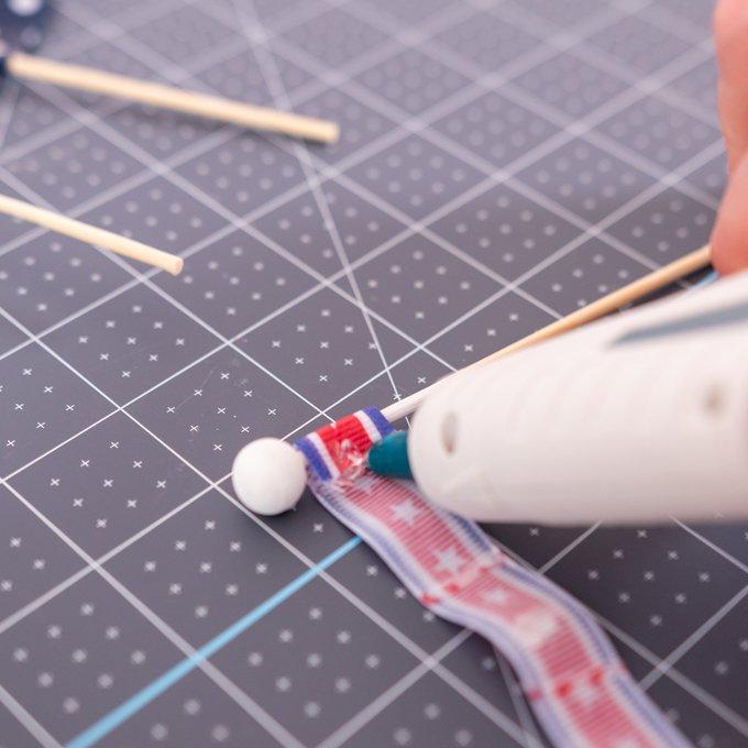 hot glue on edge of ribbon