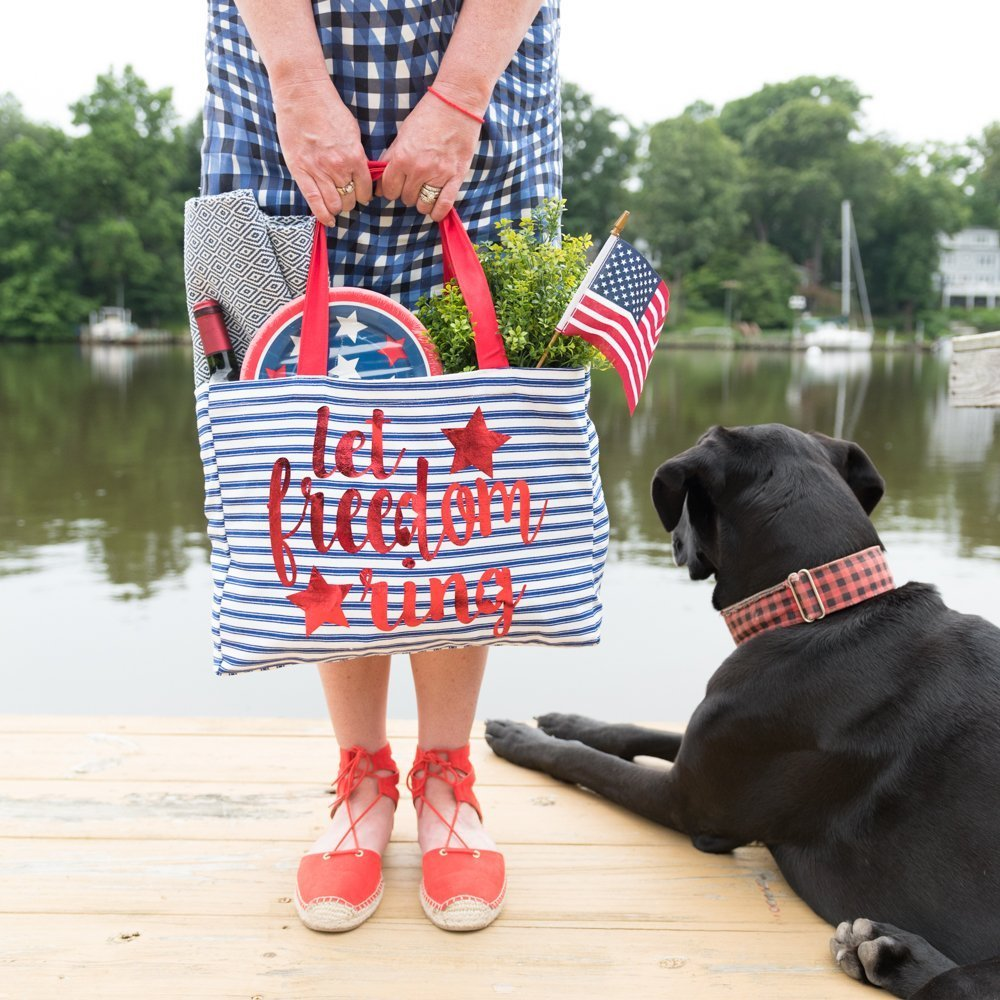 woman holding patriotic bag with dog