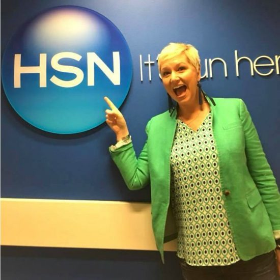 Beth Kingston in a green shirt in front of an HSN sign