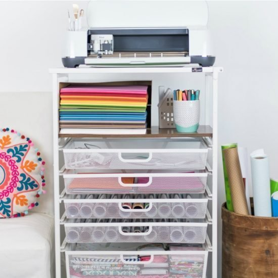 white metal cart with craft supplies and a cricut machine