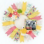 bright scrapbook paper wreath with flowers and photos