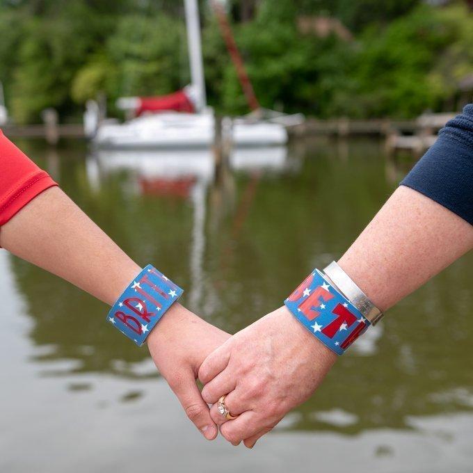 slap bracelets holding hands