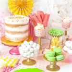 A table filled with bowls of candy and a cake