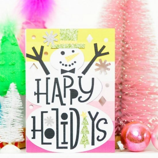 pink and yellow card with large snowman and happy holidays greeting