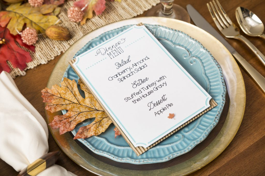 A place setting on a table, with a Cricut menu