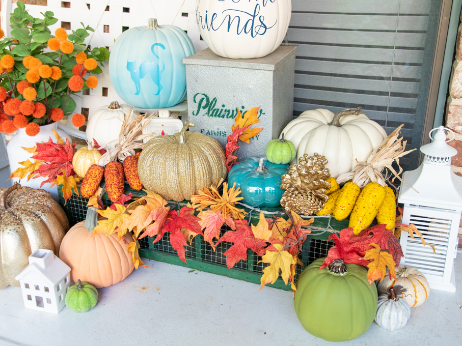 glow in the dark pumpkins outside with fall decor