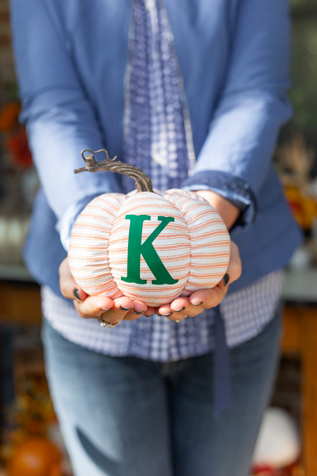 woman holding fabric pumpkin