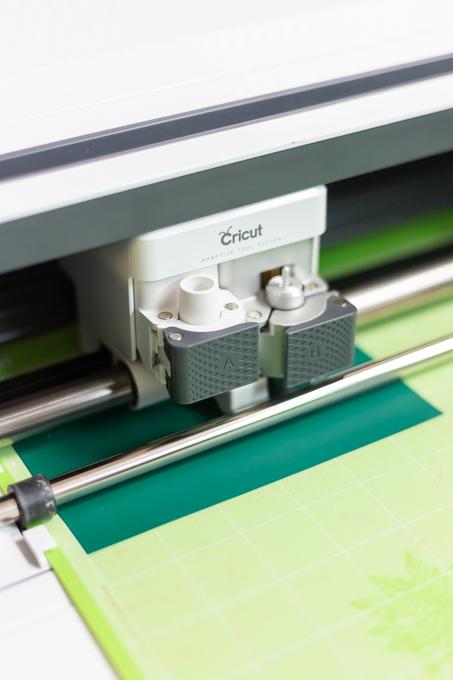 Cricut machine cutting vinyl initial
