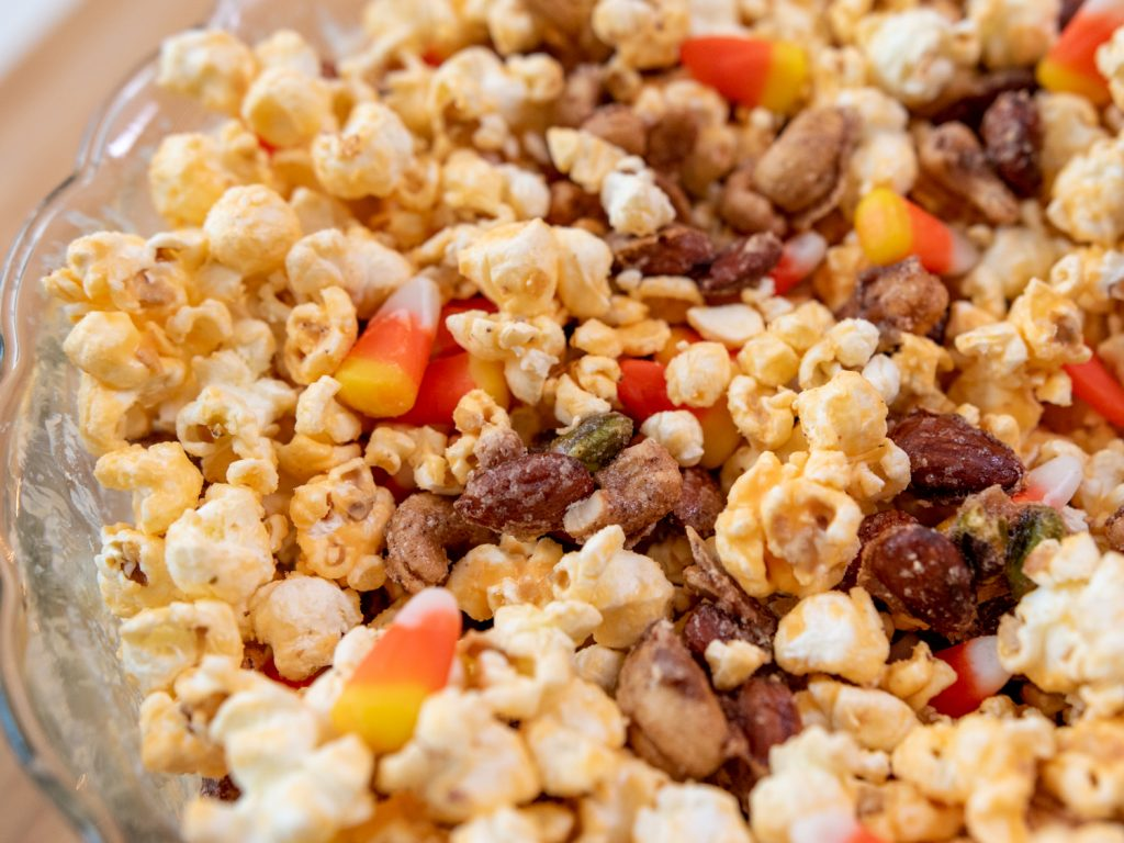 stir popcorn and nuts together