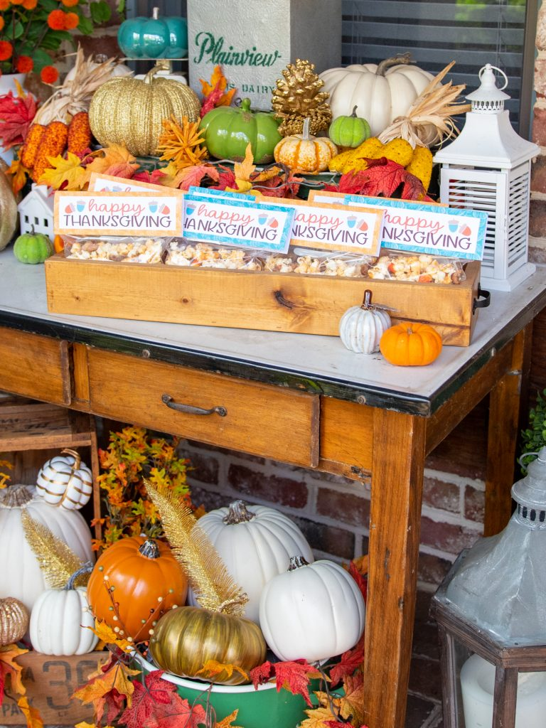 fall table with pumpkins and happy thanksgiving day popcorn gifts