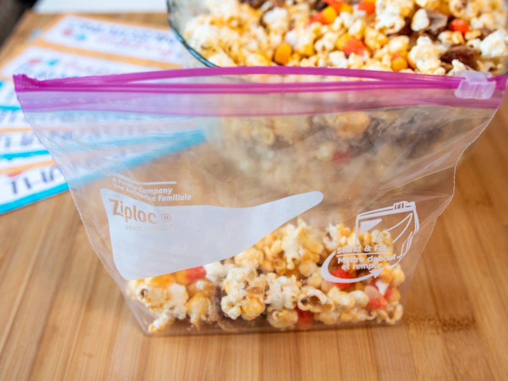 fill Ziploc® Brand Quart Size Slider Bags with popcorn mix