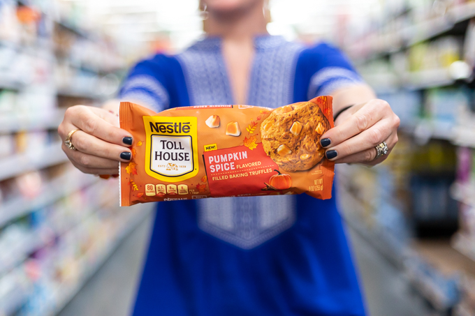 woman holding NESTLÉ® TOLL HOUSE Pumpkin Spice Morsels