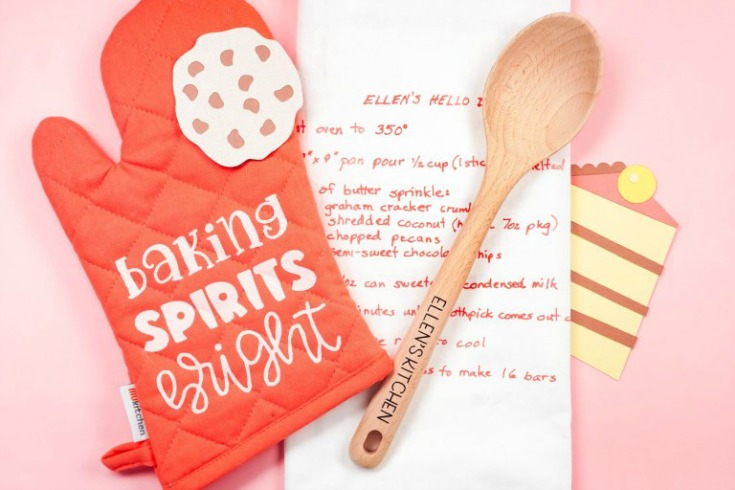 red oven mitt with a wooden spoon and recipe card