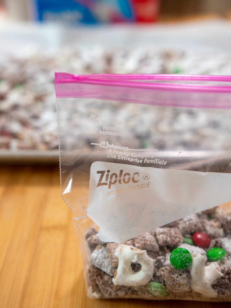 fill Ziploc® Brand Quart Size Slider Bags about ¾ full with reindeer chow and zip shut to seal