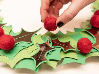 apply wool balls or berries using a hot glue gun