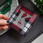 woman holding monogrammed fabric coaster