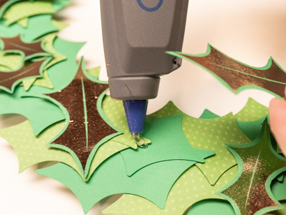 apply foil leaves using a hot glue gun