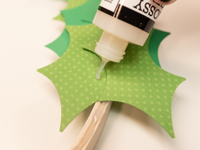 apply small amounts of liquid glue to the leaves themselves as you layer them