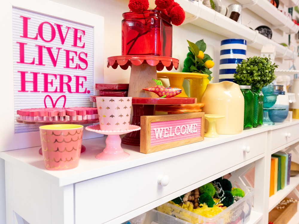 bright signs and decor on white table in craft room