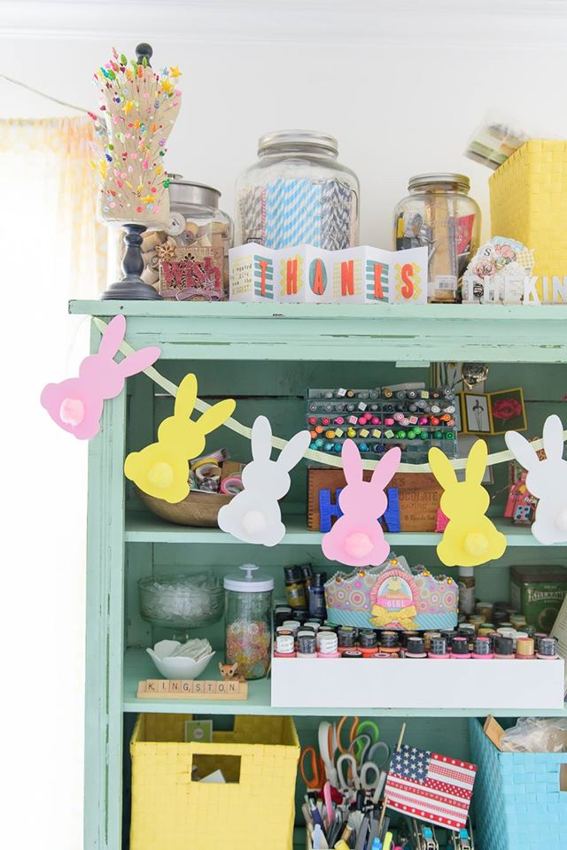 green hutch with craft supplies and bunny garland