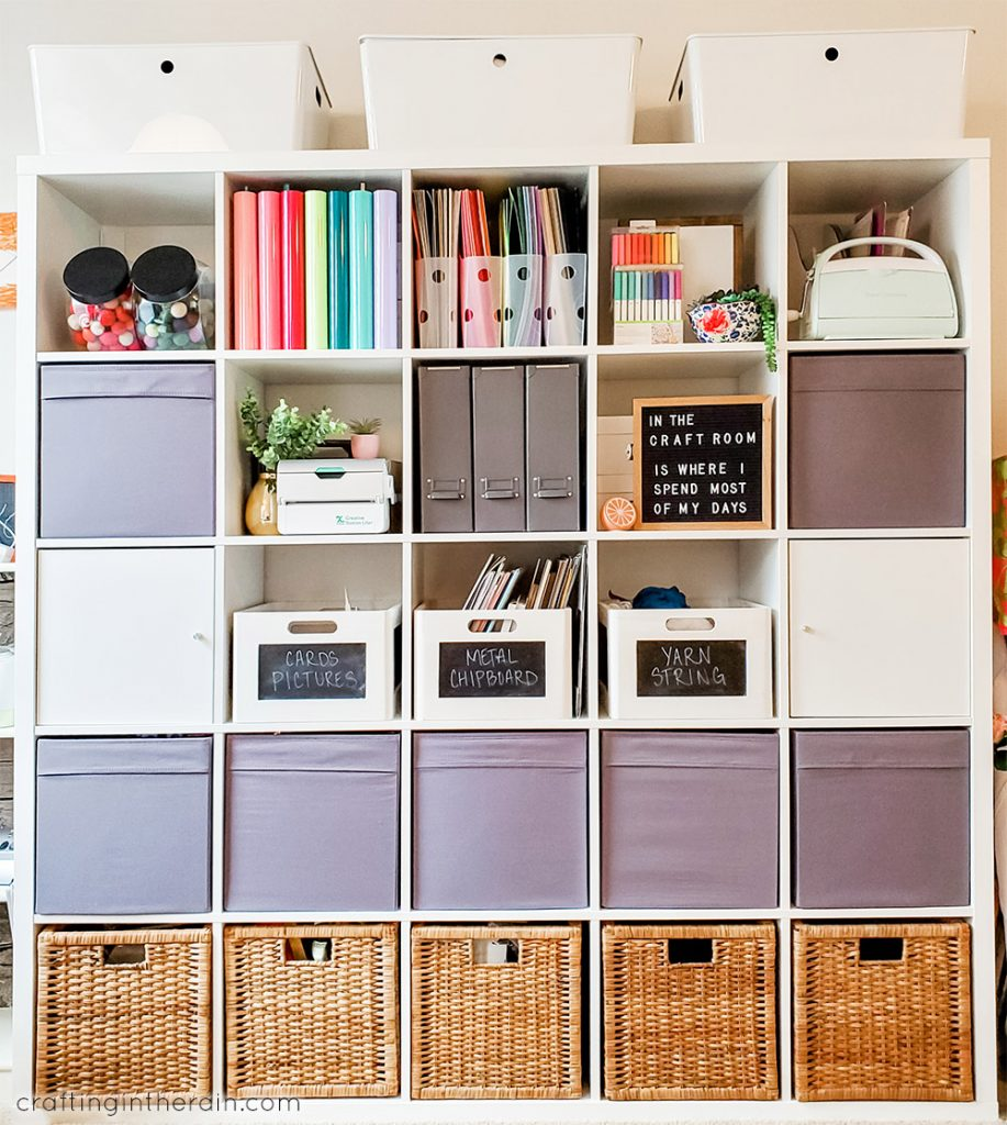 white cube shelf storage filled with craft supplies and baskets