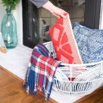 white basket makeover with pillows and blankets