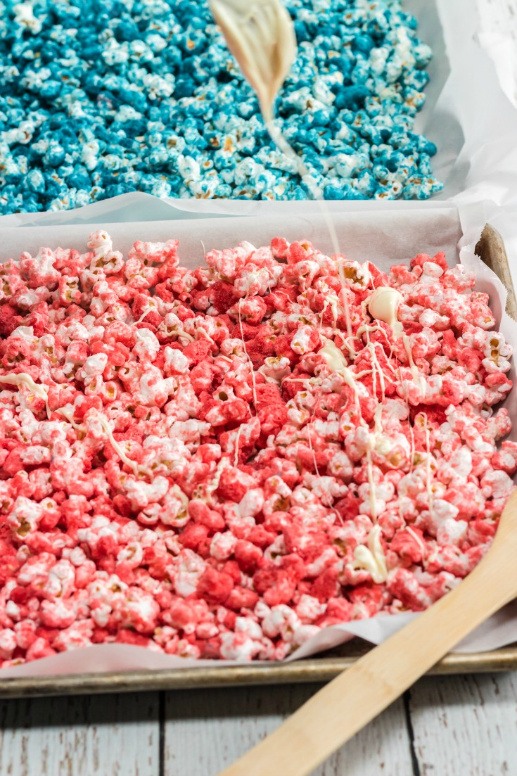 red and blue popcorn with mealted white chocolate