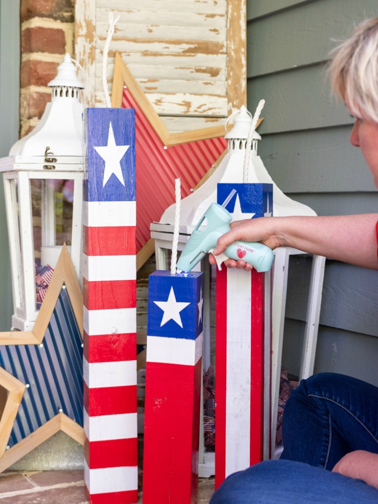 hot glue wick into firecracker base for patriotic decorations