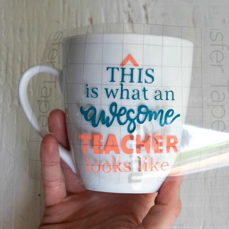 placing cricut vinyl on mug