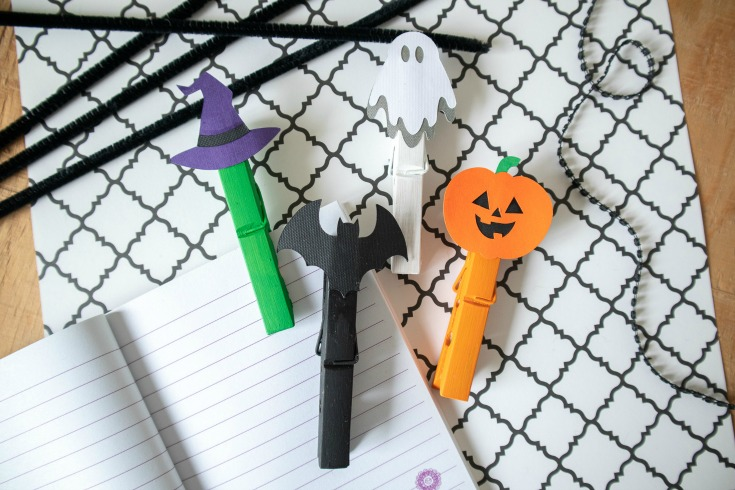 assorted painted clothespins with halloween die cuts glued on top