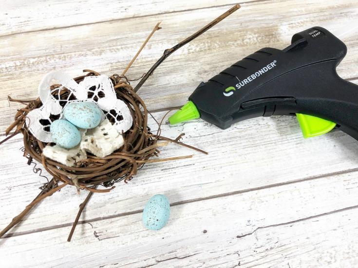 glues items into nest