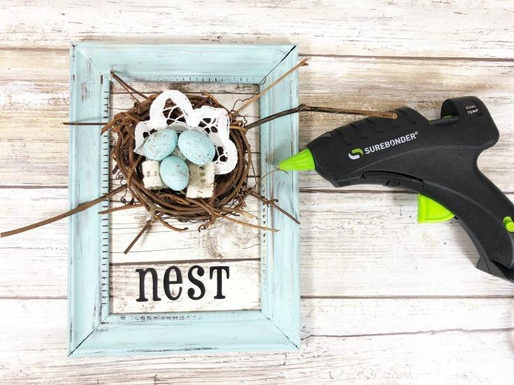 glue nest onto frame