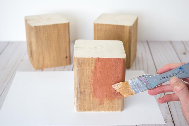 wood block being painted