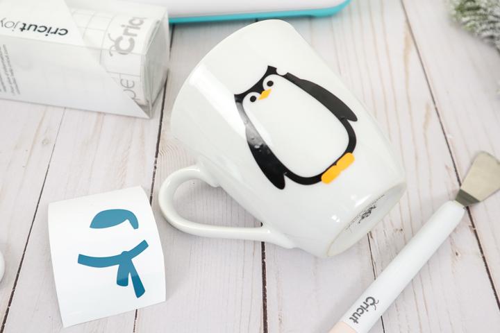 adding details to penguin mug