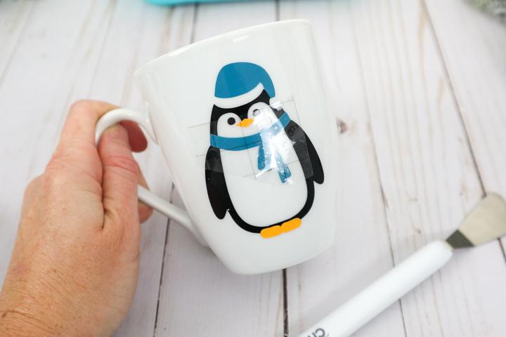 close up of penguin mug