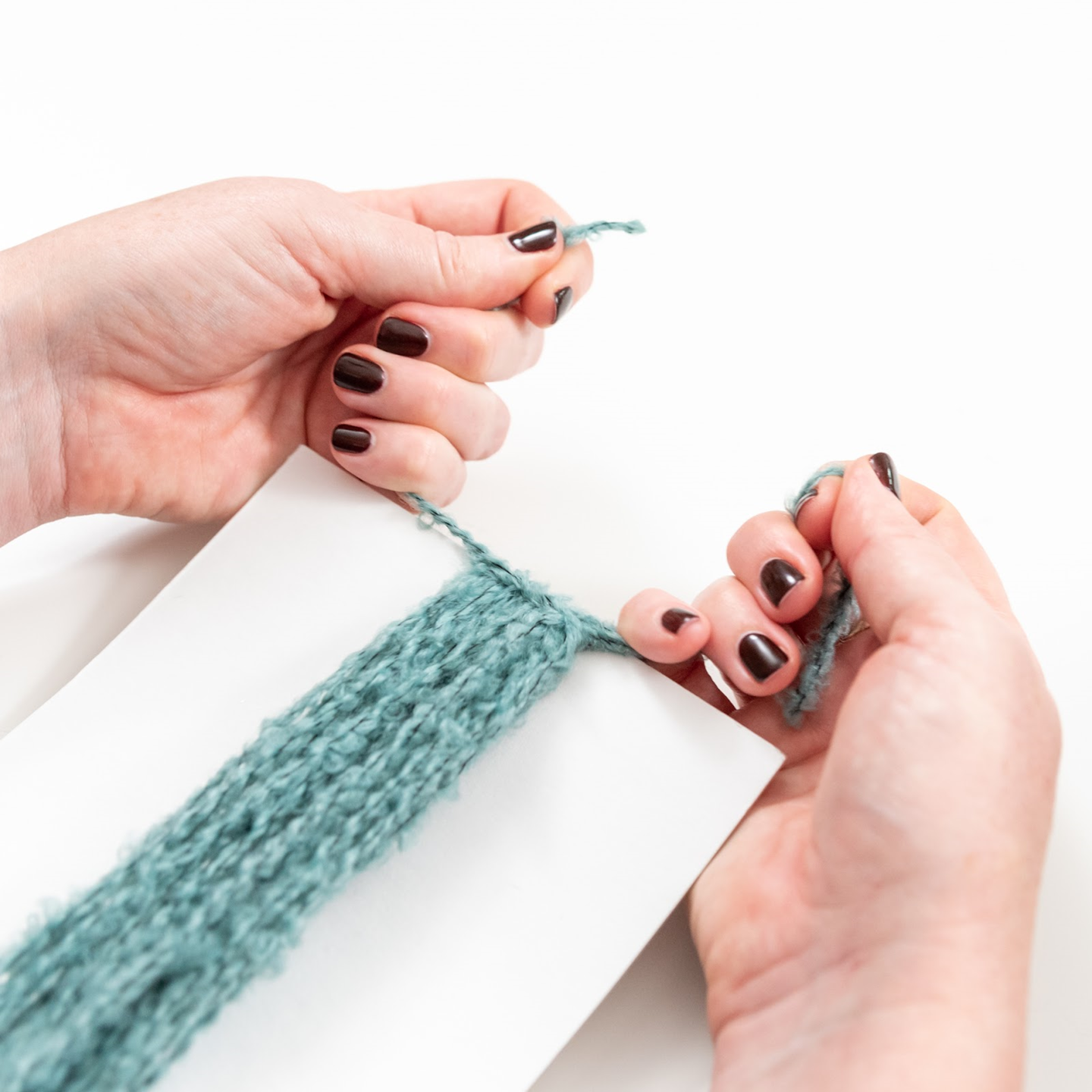 tie yarn in a knot at the top