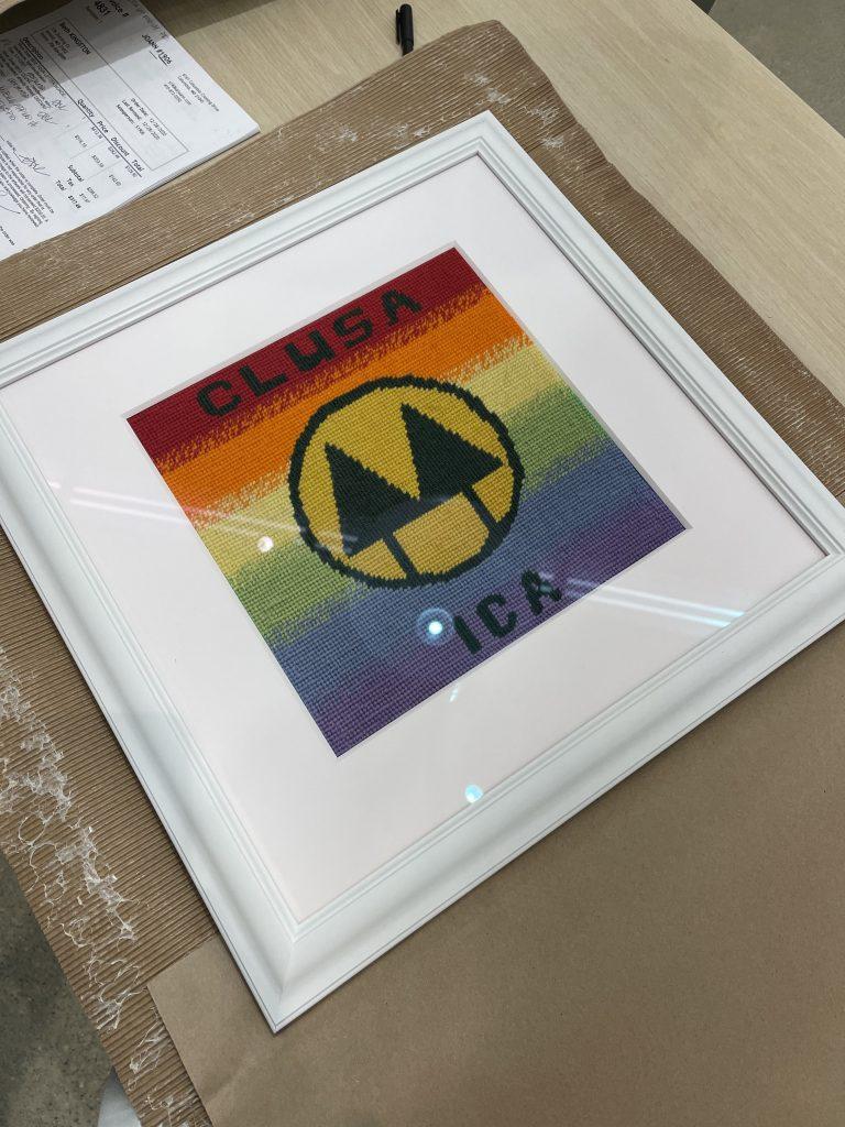 rainbow art in white frame