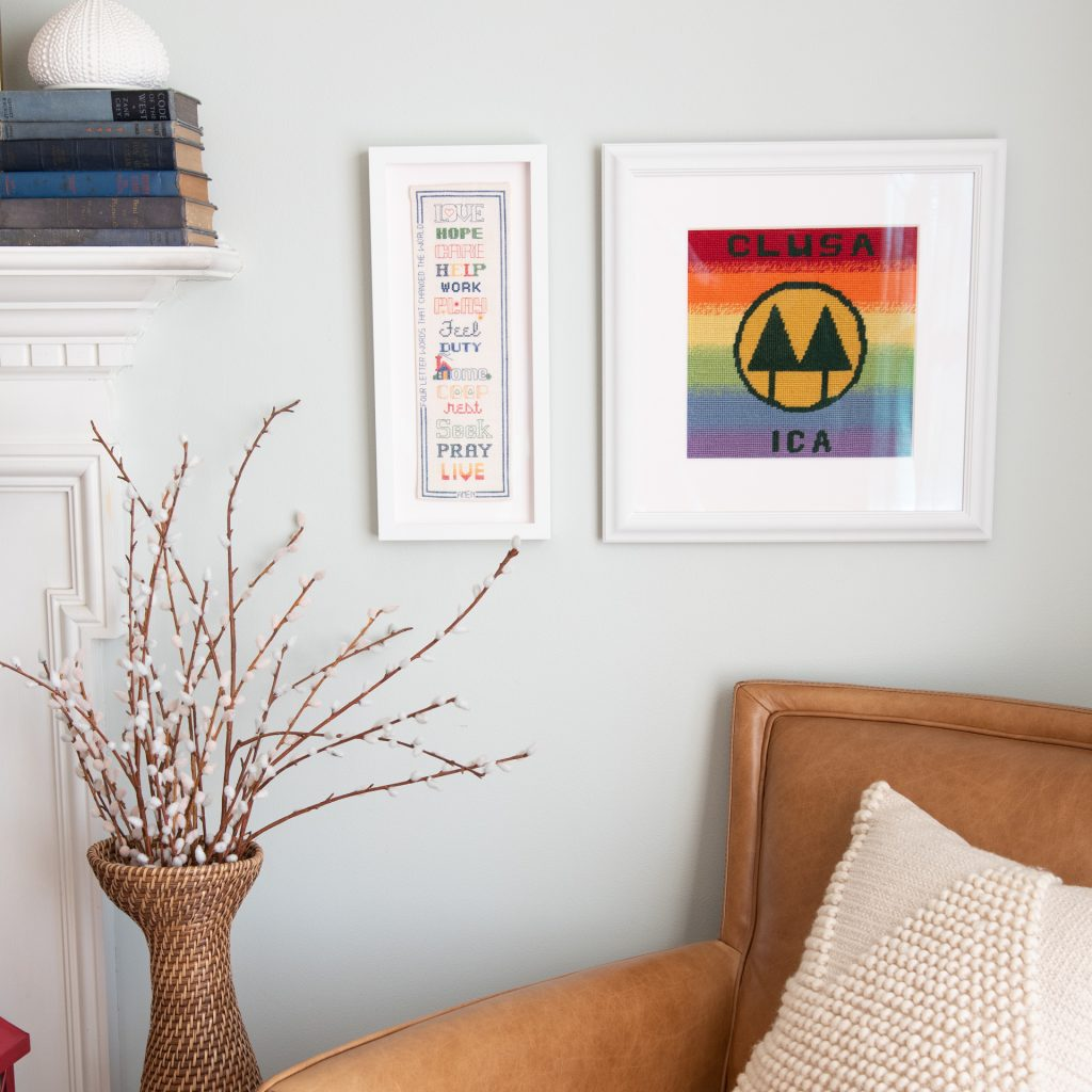 artwork on walls with tan chair