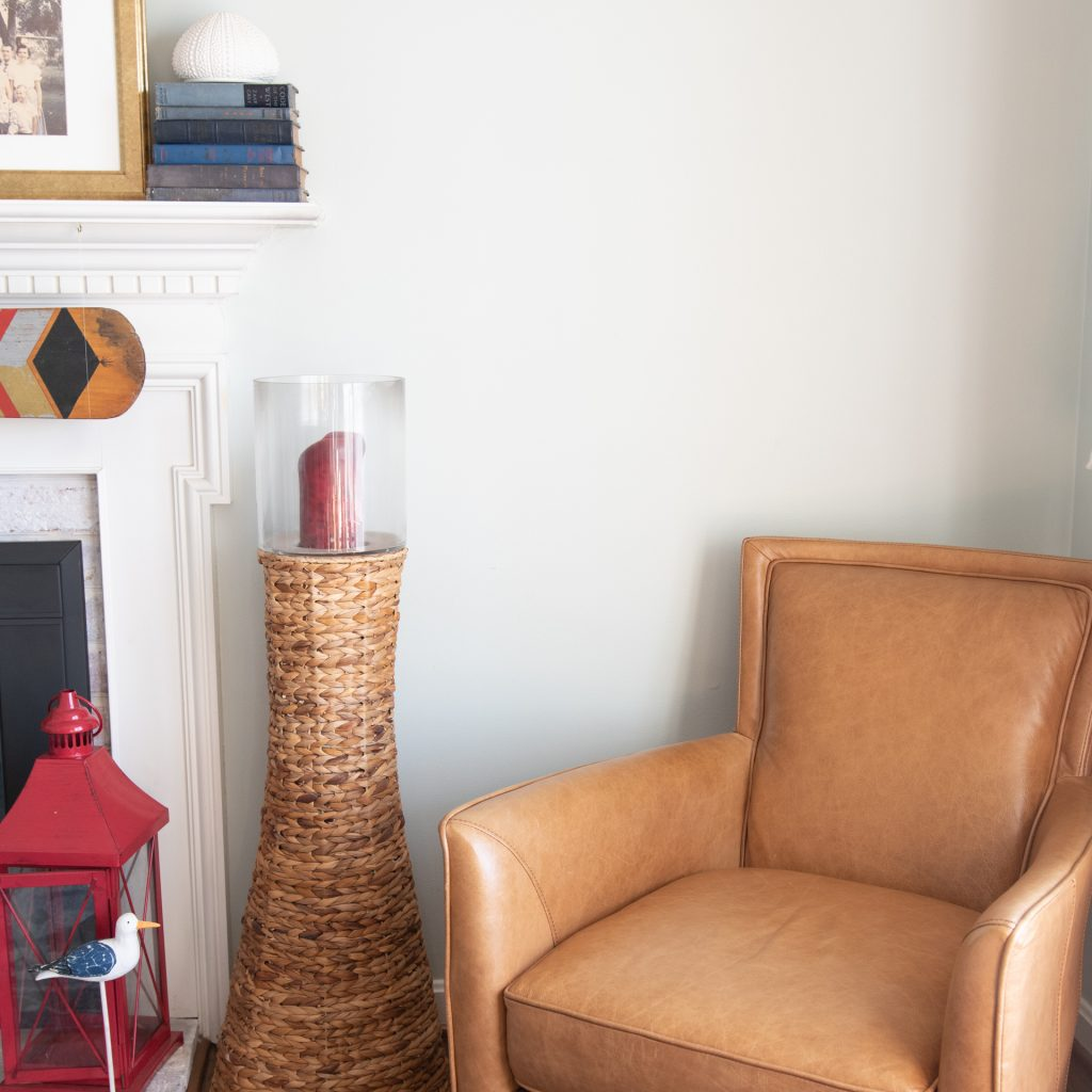 blank wall with tan chair