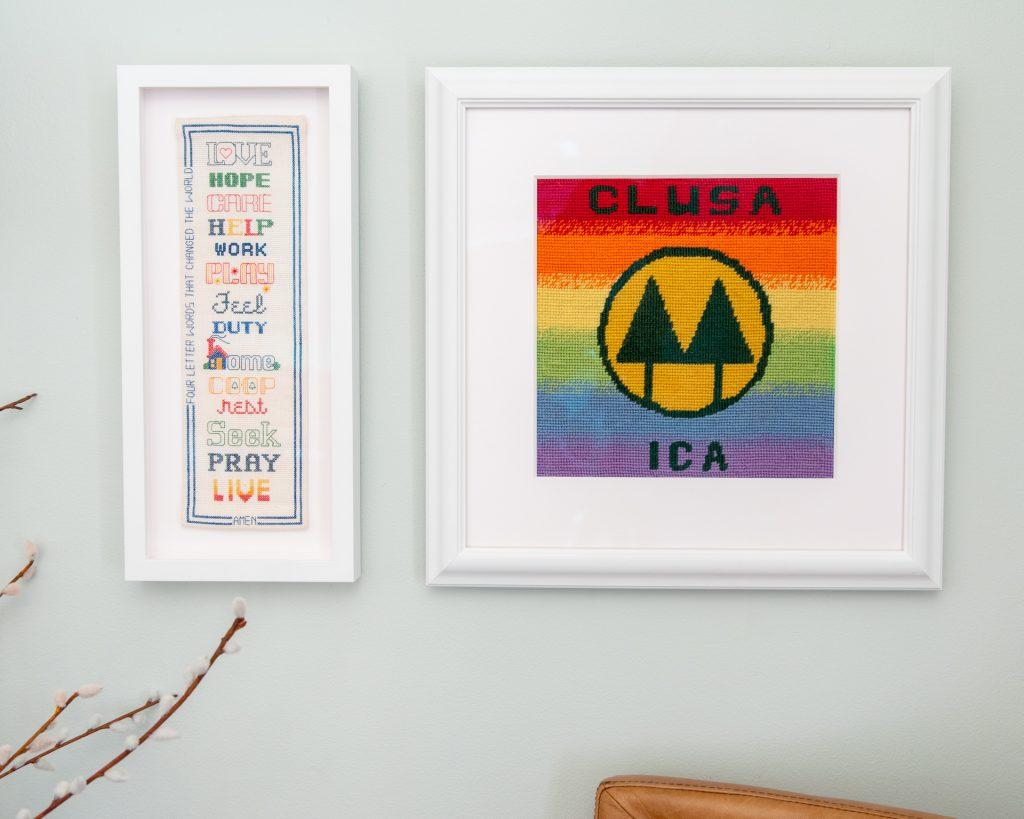 artwork in white frames on wall