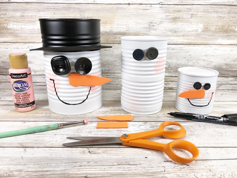group of tin snowman soup cans