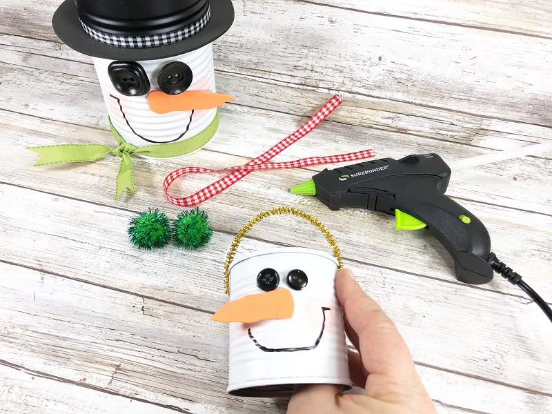 hot glue pipe cleaners to snowman soup can
