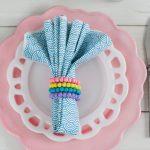 beaded napkin rings on blue napkin