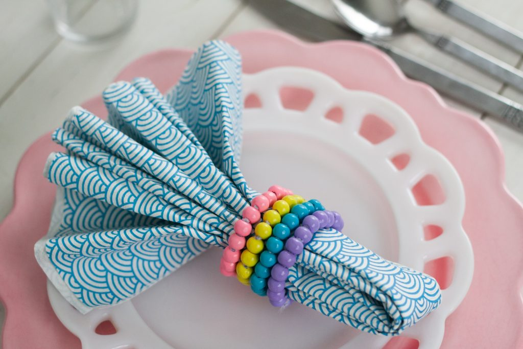 napkin on plate with beaded napkin rings