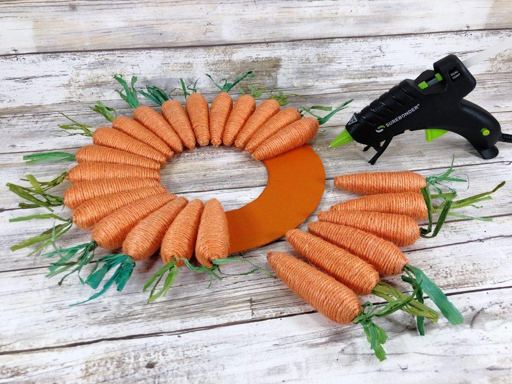 hot glue twine carrots to cardboard