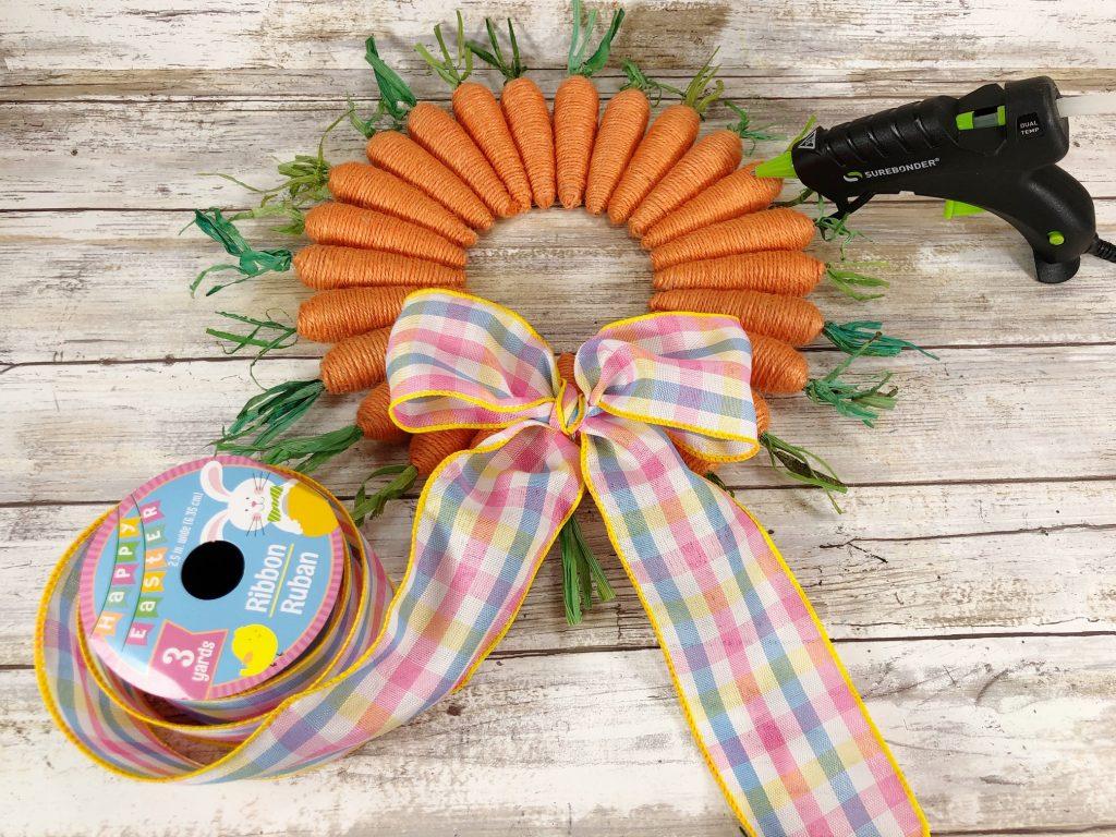 hot glue Easter bow onto carrot wreath